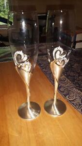 Wedding his/her wine glasses and cake knife and spatula.