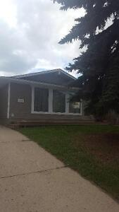 Airdrie: Pet Friendly! 1 Bdrm Split Level with Fenced Yard