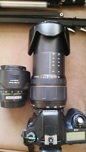 Pentax professional camera and zoom lens w pro stand and bag.