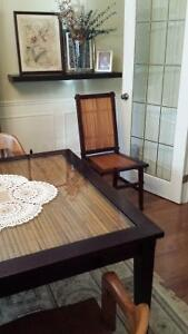 Dining table with 6 chairs , real wood and glass