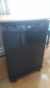 Maytag D/W on wheels set up at sink with wooden cutting board