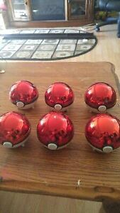 Gold plated pokemon cards in pokeballs