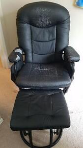 Black leather recliner/rocker with ottoman
