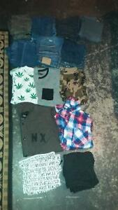 7 Paris of jeans 3 t-shirts 2 button ups 2 pairs of shorts