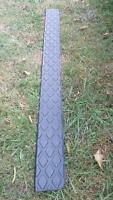 Gray plastic running board cover