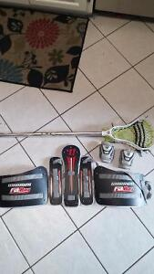 lacrosse stick, wrist guards and chest guard
