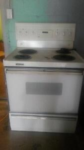 Electric stove with oven and bottom drawer