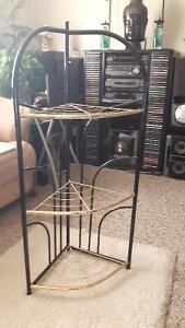 golden and black shelf / stand