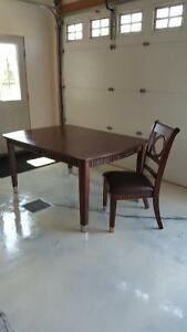 Dining room table with 6 chairs and extension