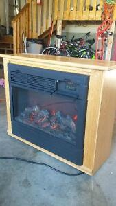 Electric fireplace in solid oak amish made cabinet