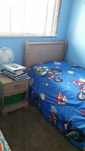 Twin bed with mattress and night stand