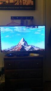 A 40 inch Samsung 1080p Curve television.