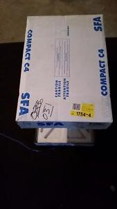 Saniflo Compact C-4 toilet with pump.. Brand new.. never opened