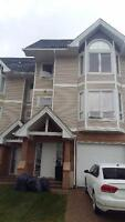 Executive 4 bdrm furnished townhouse w garage avail. Aug 1st