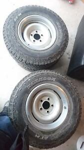 4 Hankook LT235/75R15 tires and rims