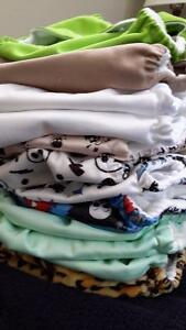 12 well loved cloth diapers-read description