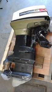 Johnson 50hp outboard, with controls.