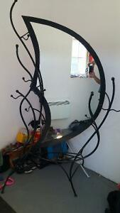 2 hand welded metal mirrors they stand around 6 plus feet.