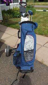 Women`s clubs, retriever and pull cart