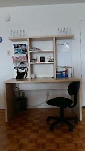 An IKEA desk with a swivel chair