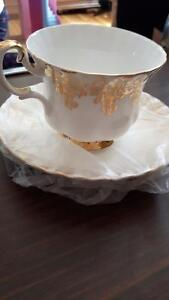 Gold plated cup and saucer
