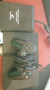 Sony Playstation 2 slim with 2 controllers and bonus