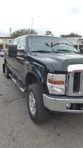 2008 Ford F-250 XLT Pickup Truck and 2014 rainbow enclosed trail