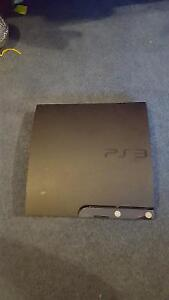 PS3 Slim, 4 controller, charger and 30 games for $200