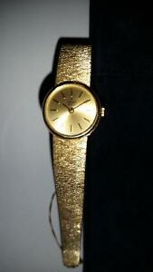 CONCORD WOMANS 14K SOLID GOLD WATCH $1295.00