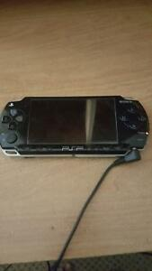 PSP 2000 series and 6 games (case included)