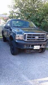 2001 Ford F-250, arctic plow, buddy ramp,  and 2 snow blowers