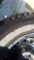 4 extra load radial tubeless tires on rims. From 2010 Forester.