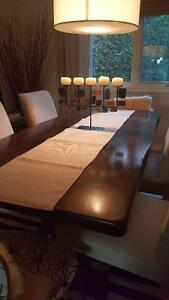 Dining room set with 4 chairs,a bench and a sideboard.