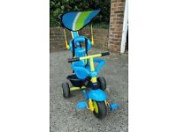 3 in 1 trike teaching children how to peddle. Bargain.