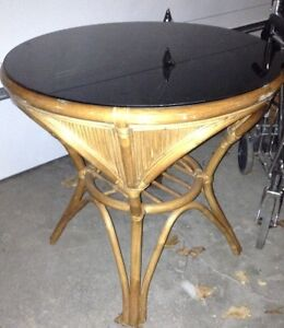 Wicker dining table with dark glass top for sale