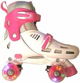 SFR Lightning Storm White/Pink Quad adjustable Roller Skates, with original box **Flashing Wheels**