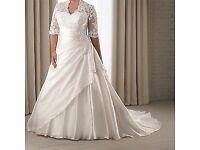 Selling Brand new wedding dress never worn.
