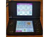 Dsi console (one with built in camera)with 5games and charger/1 game is pokermon/cash or swaps
