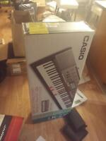 Casio LK-230 Lighted Personal Keyboard, 61 Keys + stand