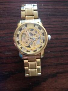 Mce watchwith watch movement showing on front and back 45$
