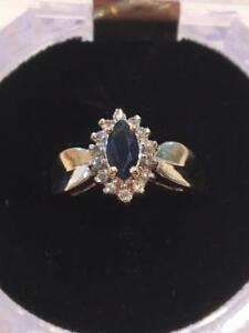 #1142 14K Sapphire surrounded by Diamonds! Size 6 3/4