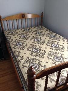 Twin bed with boxspring and wooden frame