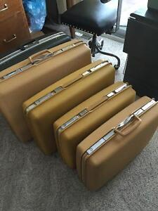 vintage suitcases $35 each. clean and good shap,