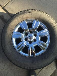 (4) Ford rims with mounted tires