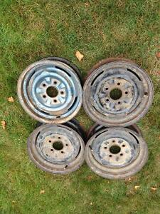 Set of 4 steel rims off a 1964 Pontiac Parisienne