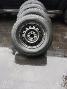 LIKE NEW HIGH PERFORMANCE SAILUN ICEBLAZER WINTER TIRES 235/70/16 ON STEEL RIMS.