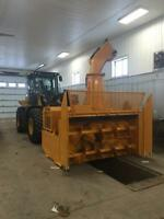 Loader mounted snow blower.