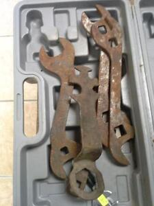 Assorted antique wrenches and tools