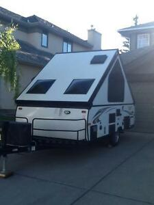 Flagstaff hard-sided pop-up travel trailer -as new condition.