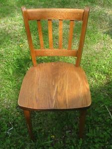 Two Vintage Solid Oak Chairs